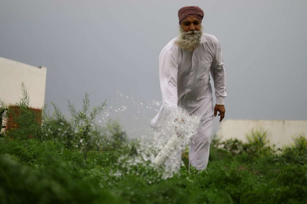 Farmer using Natraj Krishi Pipe